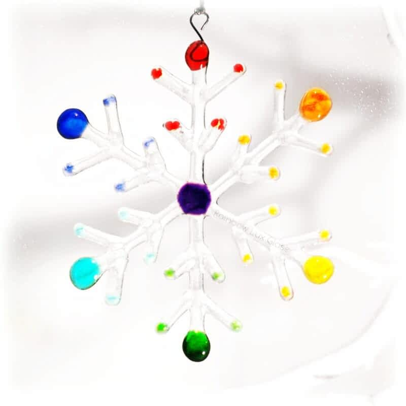 A large clear snowflake with Rainbow coloured tips.