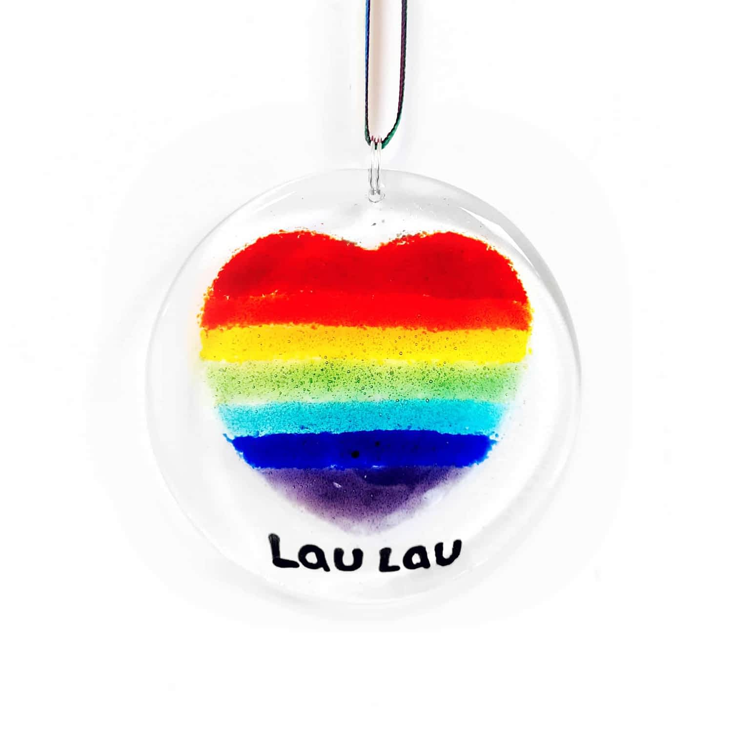 A round circle suncatcher featuring a heart made with rainbow colours in vertical stripes.