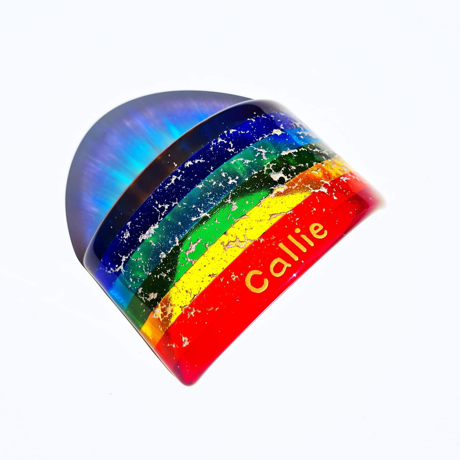 A Personalised Rainbow Bridge with cremation ashes fused insode the glass, on a white background.