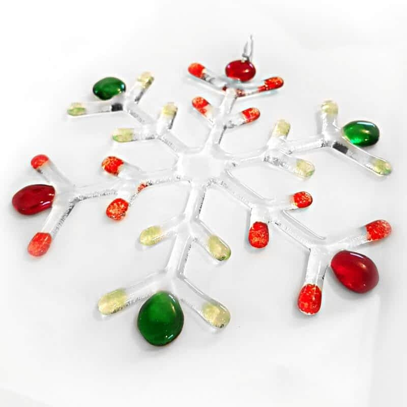 A large clear snowflake with Red and Green coloured tips on a white background.
