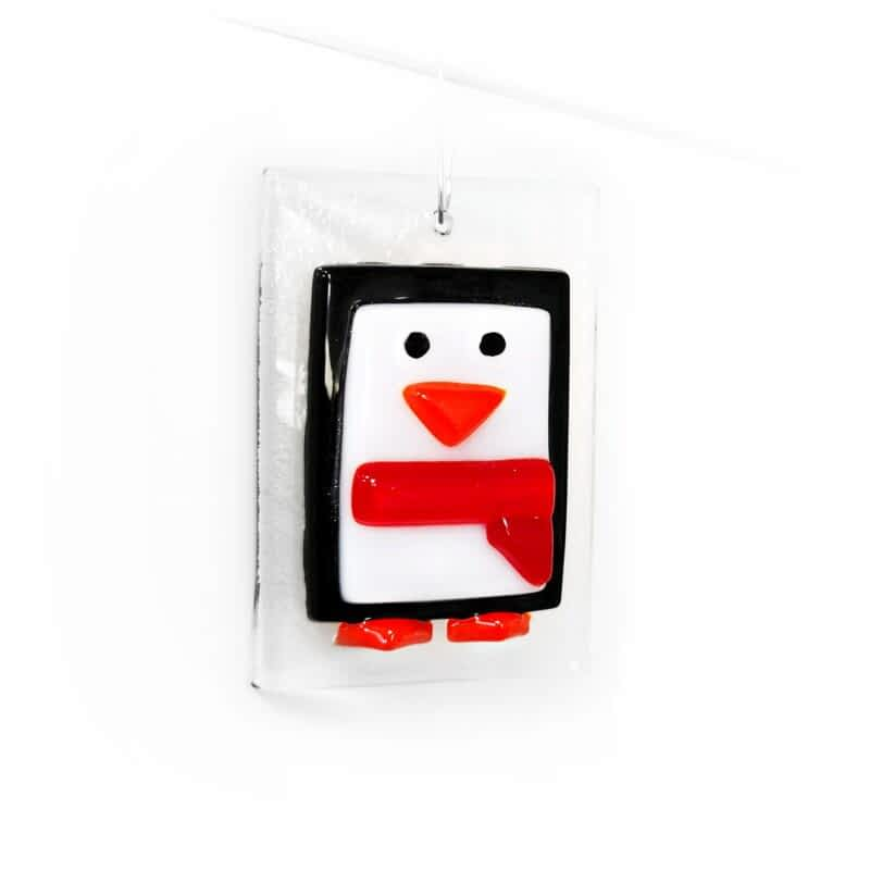 A black and white penguin small Christmas tree decoration with a red scarf.