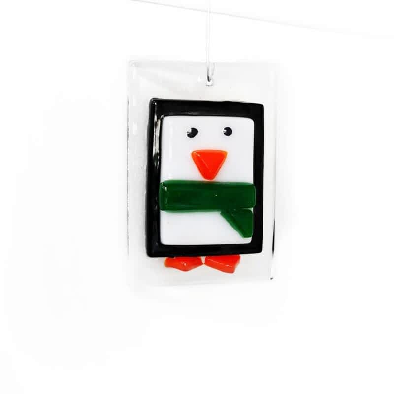 A black and white penguin small Christmas tree decoration with a green scarf.