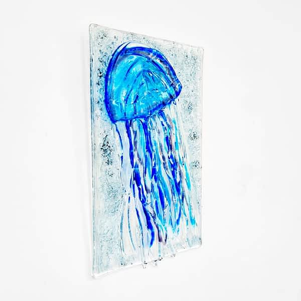 Blue Jellyfish made of glass, hanging on the wall.