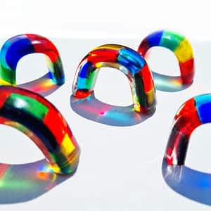 Tiny Small Little Glass Rainbows on a white background