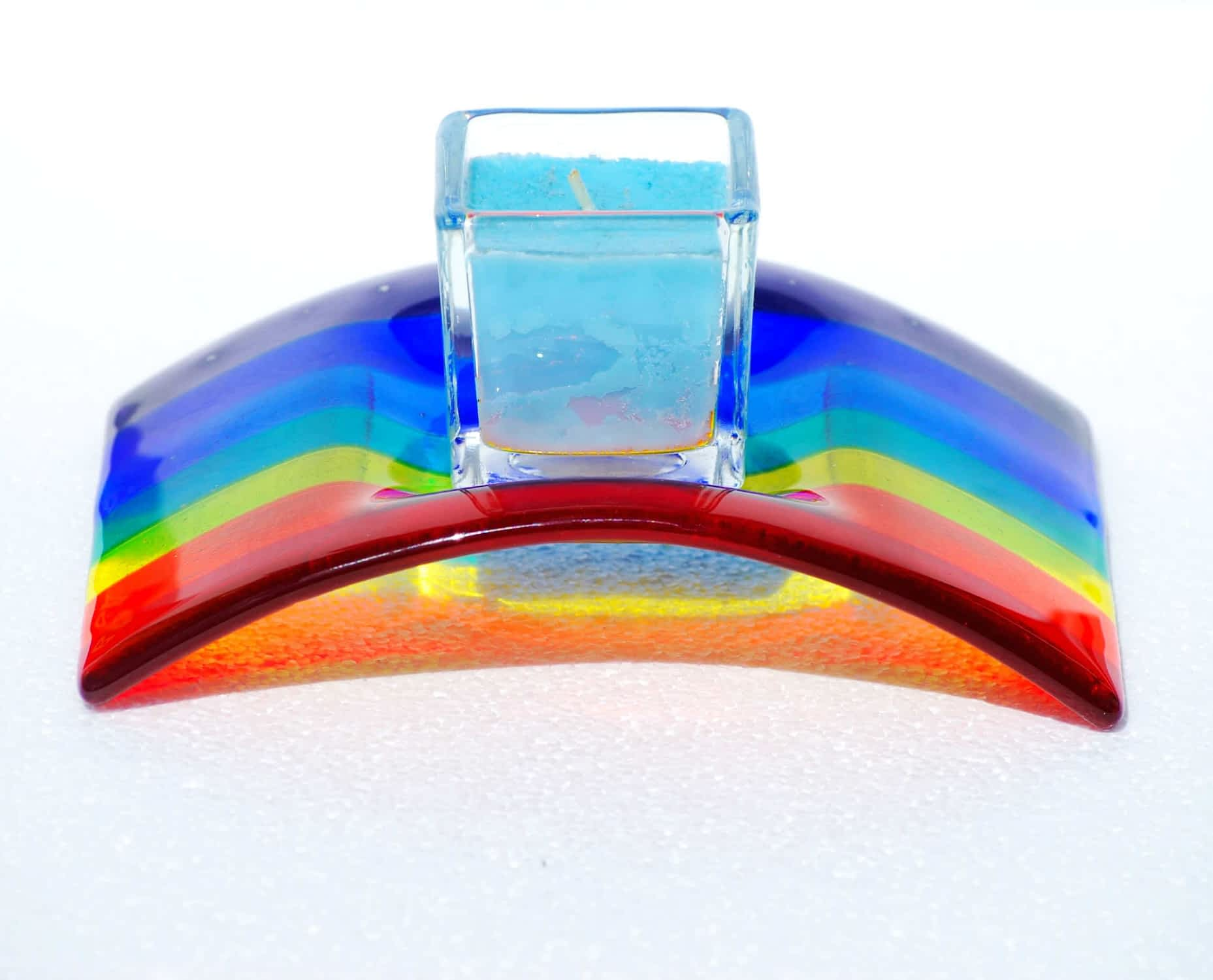 A Rainbow Candle Bridge Arch personalised in silver enamel with space for a candle or tealight in the centre recess.