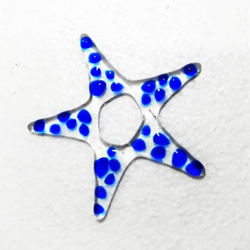 Clear glass star with blue glass on top