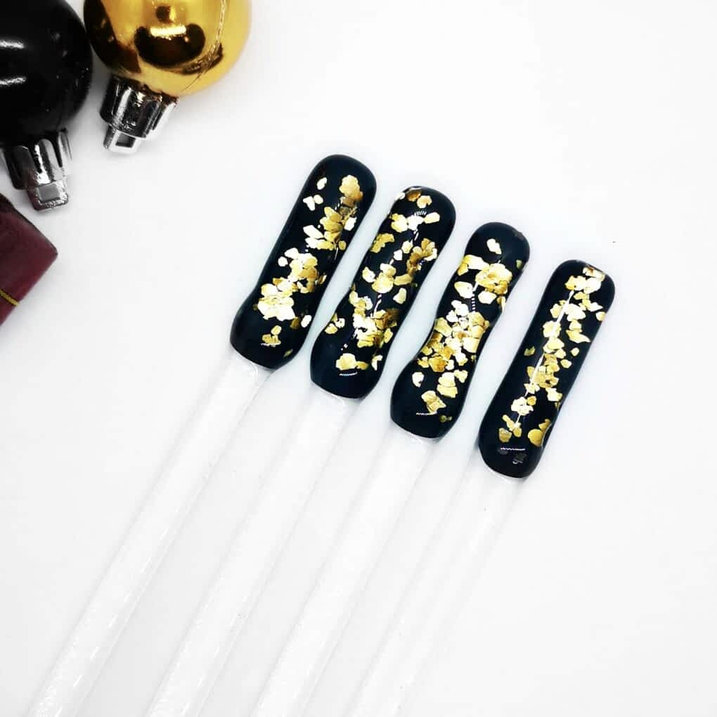 15cm Drinks Swizzle Sticks with a black background with silver or gold glitter fused inside.