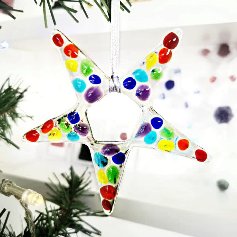 Clear glass star with rainbow coloured glass on top