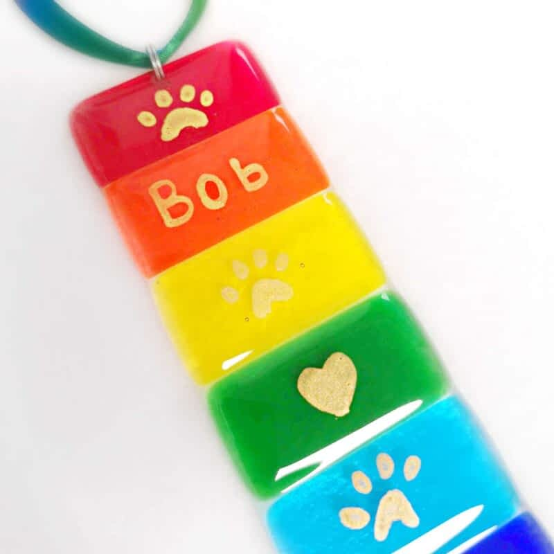7 colours of the rainbow individual rectangles of glass on clear glass. Gold text with paw prints and hearts.