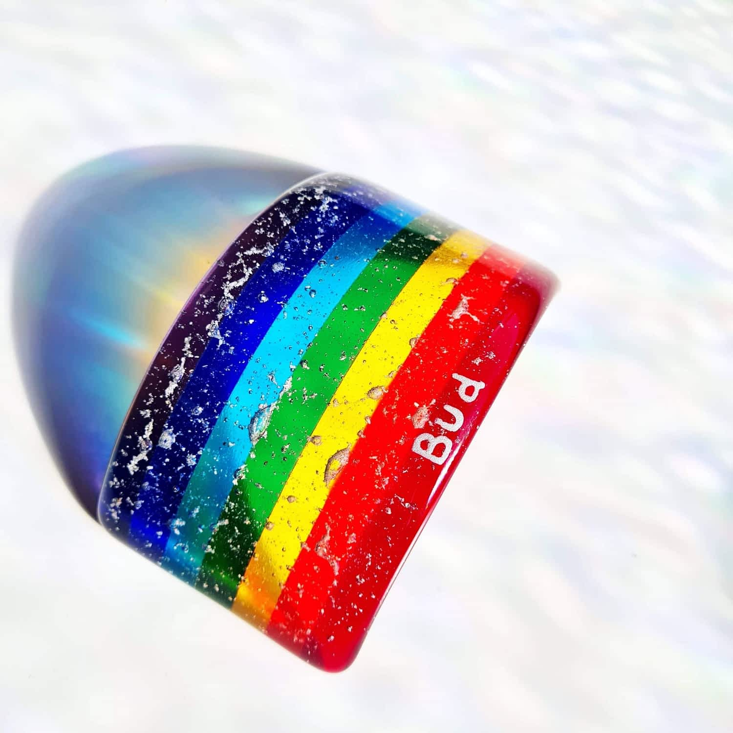 A rainbow bridge featuring cremation ashes fused inside the glass with silver personalised text.